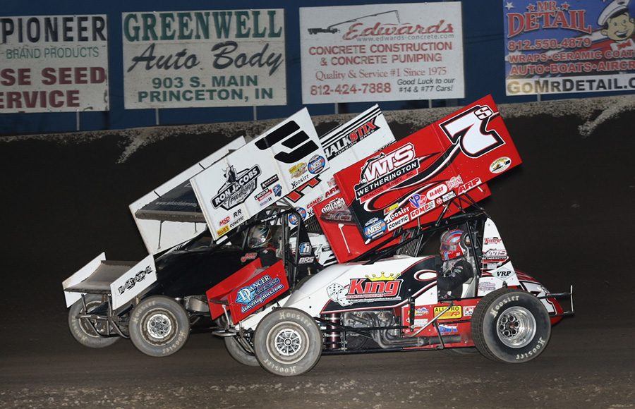Jason Sides (7s), Jac Haudenschild (3) and Parker Price-Miller battle during Saturday's World of Outlaws NOS Energy Drink Sprint Car Series event at Tri-State Speedway. (Neil Cavanah Photo)