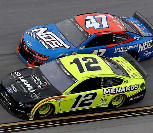 Ryan Blaney (12) battles Ricky Stenhouse Jr. during Monday's GEICO 500 at Talladega Superspeedway. (Chris Graythen/Getty Images Photo)