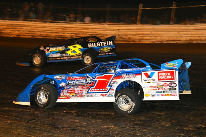 Brandon Sheppard (1) races under Kyle Strickler during Saturday's World of Outlaws Morton Buildings Late Model Series feature at Volunteer Speedway. (Michael Moats Photo)