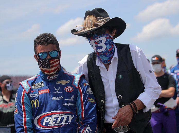 NASCAR Hall of Famer Richard Petty (right) stands with his driver Bubba Wallace ahead of Monday's GEICO 500 at Talladega Superspeedway. (Chris Graythen/Getty Images Photo)