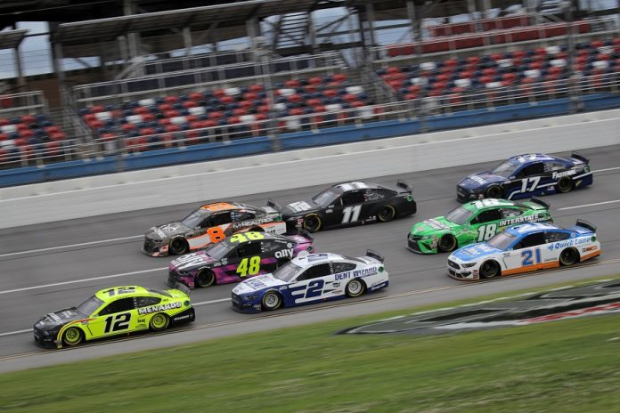 Ryan Blaney (12) leads a pack of cars during Monday's GEICO 500 at Talladega Superspeedway. (Chris Graythen/Getty Images photo)