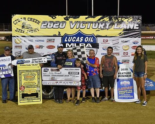 Jesse Stovall and his crew in victory lane on Thursday night at Outlaw Motor Speedway. (Lloyd Collins Photo)