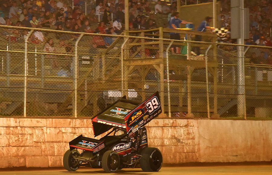 Anthony Macri passes under the checkered flag to win Wednesday's Ollie's Bargain Outlet All Star Circuit of Champions feature at Port Royal Speedway. (Paul Arch Photo)