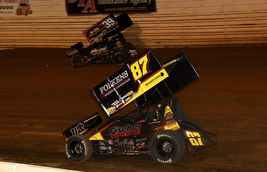Aaron Reutzel (87) races under Anthony Macri during Wednesday's Ollie's Bargain Outlet All Star Circuit of Champions event at Port Royal Speedway. (Paul Arch Photo)