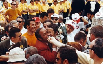 1969 Indianapolis 500 winner Mario Andretti receiving a kiss from car owner Andy Granatelli in victory lane. (IMS Archives Photo)