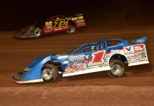 Brandon Sheppard (1) races under Michael Norris at Lernerville Speedway. (Paul Arch photo)