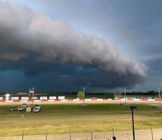Storm clouds move in over Grundy County Speedway on Friday night. (Stan Kalwasinski Photo)