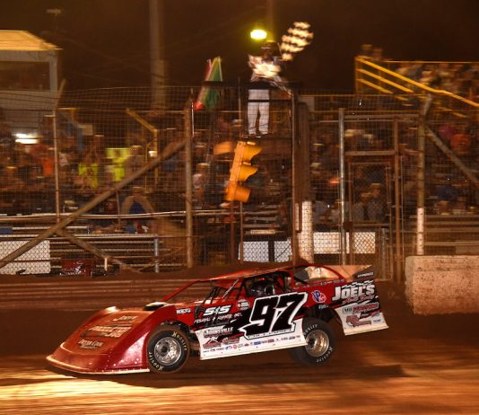 Cade Dillard takes the checkered flag at Lernerville Speedway. (Paul Arch photo)