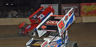 Chad Kemenah (15) races under Caleb Griffith at Fremont Speedway. (Mike Campbell photo)