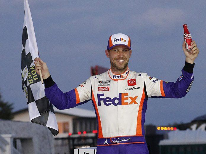 Denny Hamlin in victory lane following Sunday's NASCAR Cup Series race at Pocono Raceway. (HHP/Andrew Coppley Photo)