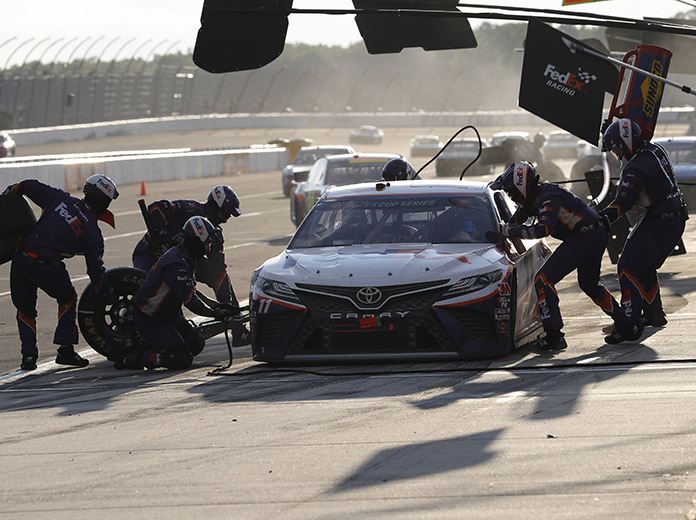 Denny Hamlin's pit crew goes to work late in Sunday's race at Pocono Raceway. (HHP/Andrew Coppley Photo)