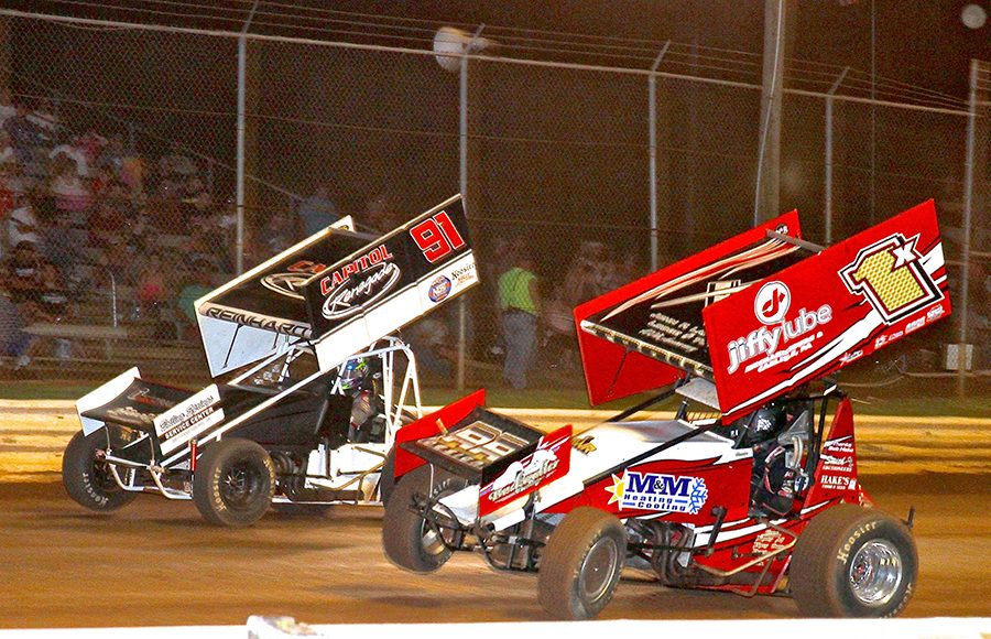 Chad Trout (1x) battles Kyle Reinhardt during Monday's PA Speedweek feature at Lincoln Speedway. (Dan Demarco Photo)