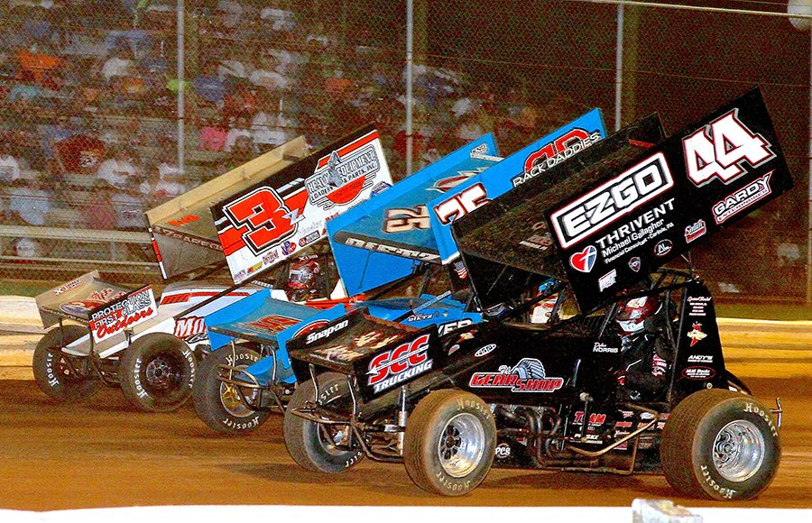 Dylan Norris (44), Chase Dietz (75c) and Brock Zearfoss race three-wide during Monday's PA Speedweek feature at Lincoln Speedway. (Dan Demarco Photo)