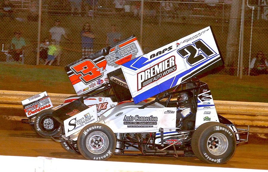 Brian Montieth (21) battles Brock Zearfoss during Monday's PA Speedweek feature at Lincoln Speedway. (Dan Demarco Photo)