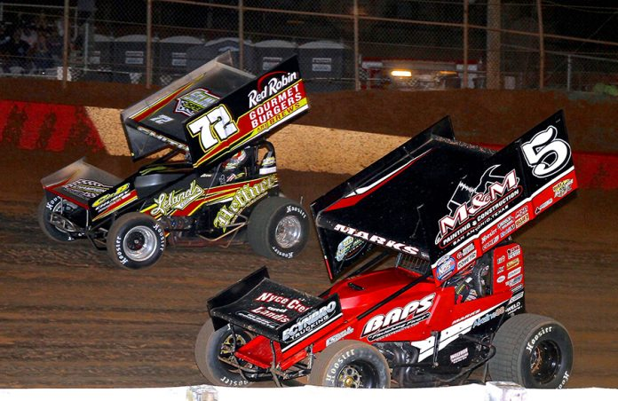 Brent Marks (5) battles Ryan Smith during Monday's PA Speedweek feature at Lincoln Speedway. (Dan Demarco Photo)