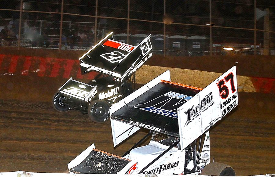 Kyle Larson (57) races under Christopher Bell during Monday's PA Speedweek feature at Lincoln Speedway. (Dan Demarco Photo)