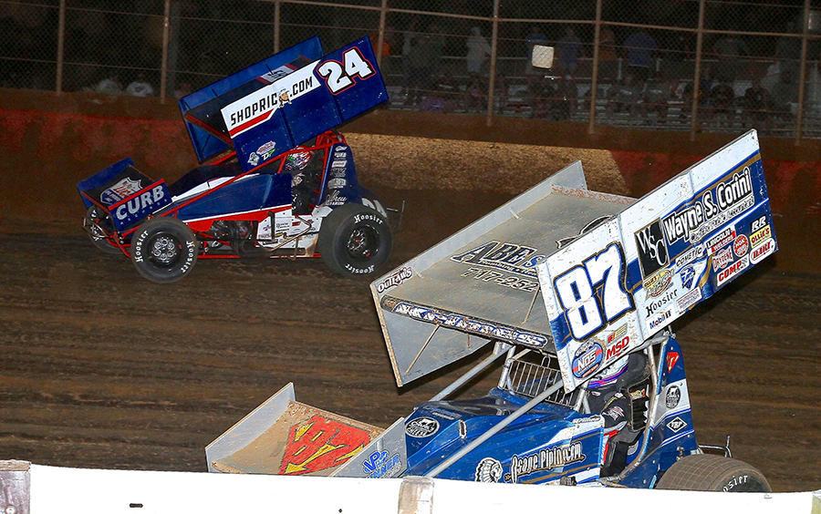 Alan Krimes (87) races under Rico Abreu during Monday's PA Speedweek feature at Lincoln Speedway. (Dan Demarco Photo)