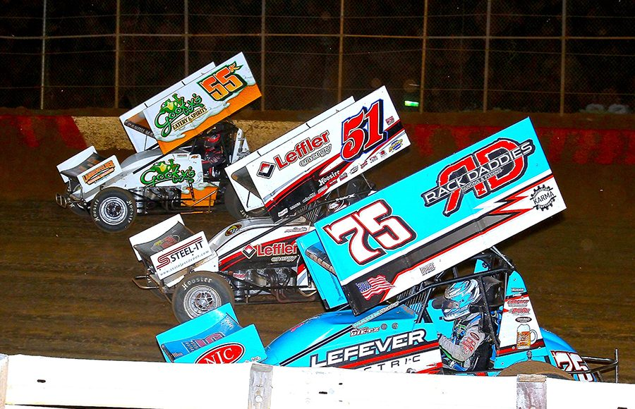Chase Dietz (75), Freddie Rahmer (51) and Robbie Kendall battle three-wide during Monday's PA Speedweek feature at Lincoln Speedway. (Dan Demarco Photo)