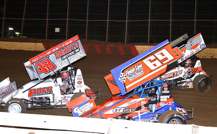 Danny Dietrich (48), Tim Glatfelter (69) and Brock Zearfoss battle for position during Monday's PA Speedweek feature at Lincoln Speedway. (Dan Demarco Photo)