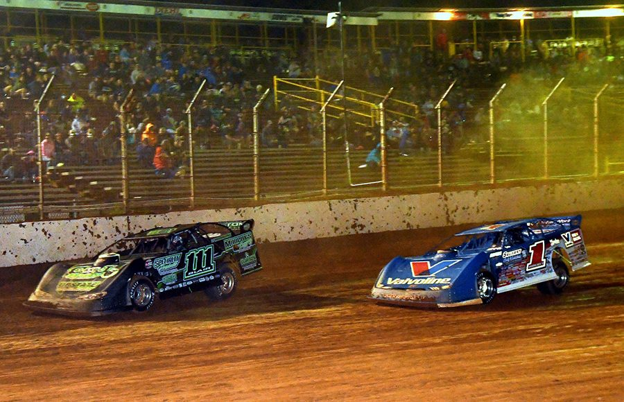 Max Blair (111) races ahead of Brandon Sheppard during Thursday's Firecracker 100 preliminary event at Lernerville Speedway. (Hein Brothers Photo)