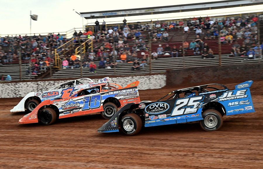 Chub Frank (1*), Jared Miley (10) and Mason Zeigler battle during preliminary action ahead of Thursday's Firecracker 100 preliminary feature at Lernerville Speedway. (Hein Brothers Photo)