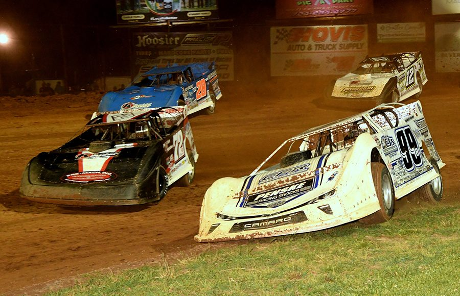 Boom Briggs (99B), Jason Covert (72), Dennis Erb Jr. (28) and Ashton Winger battle it out during Thursday's Firecracker 100 preliminary event at Lernerville Speedway. (Hein Brothers Photo)