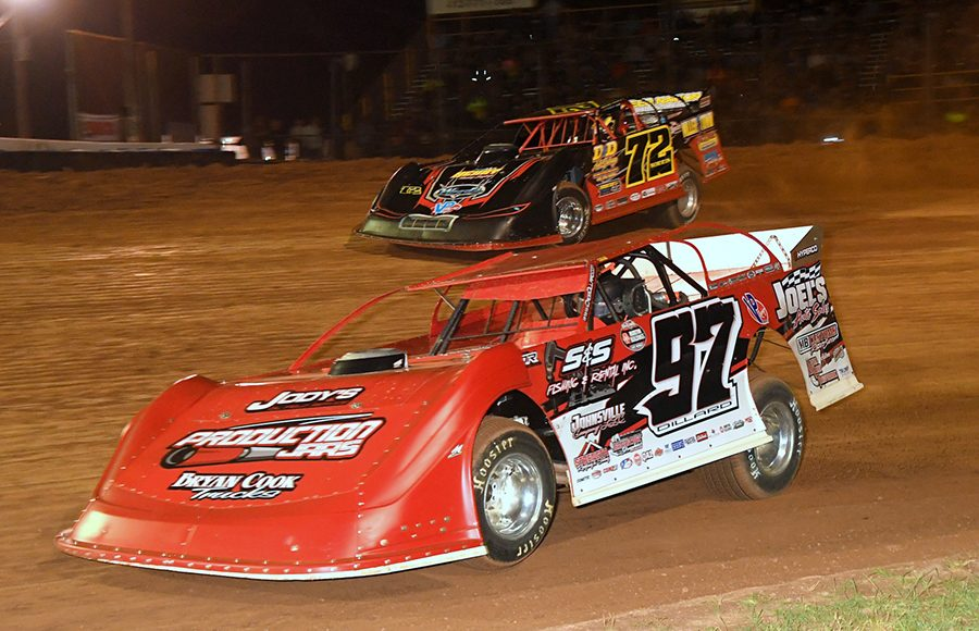 Cade Dillard (97) battles alongside Mike Norris during Thursday's Firecracker 100 preliminary event at Lernerville Speedway. (Hein Brothers Photo)