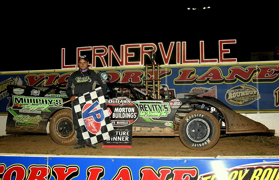Max Blair poses in victory lane after winning Thursday's Firecracker 100 preliminary feature at Lernerville Speedway. (Hein Brothers Photo)