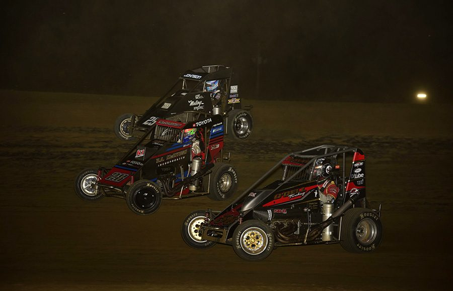 Mitchell Davis (56), Ace McCarthy (28) and Chase Johnson battle for position during Friday's POWRi Lucas Oil National Midget League feature at Charleston Speedway. (Mark Funderburk Photo)