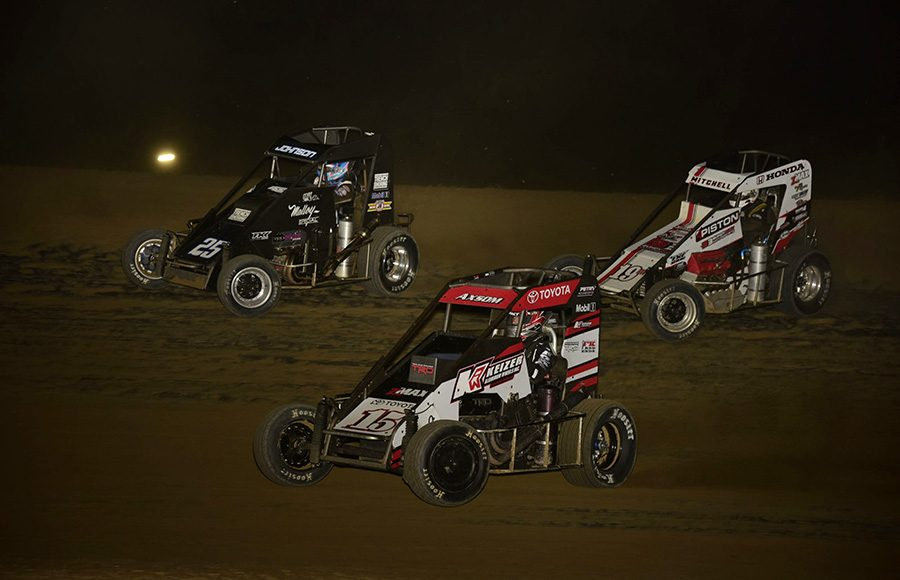 Emerson Axsom (15), Ethan Mitchell (19M) and Chase Johnson race for position during Friday's POWRi Lucas Oil National Midget League feature at Charleston Speedway. (Mark Funderburk Photo)