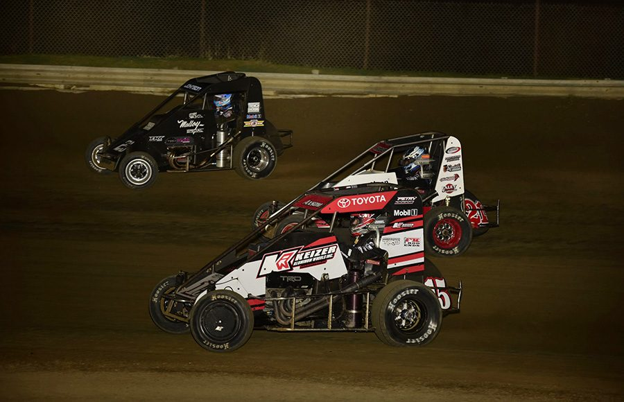 Emerson Axsom (15), Emilio Hoover (21K) and Chase Johnson during Friday's POWRi Lucas Oil National Midget League feature at Charleston Speedway. (Mark Funderburk Photo)