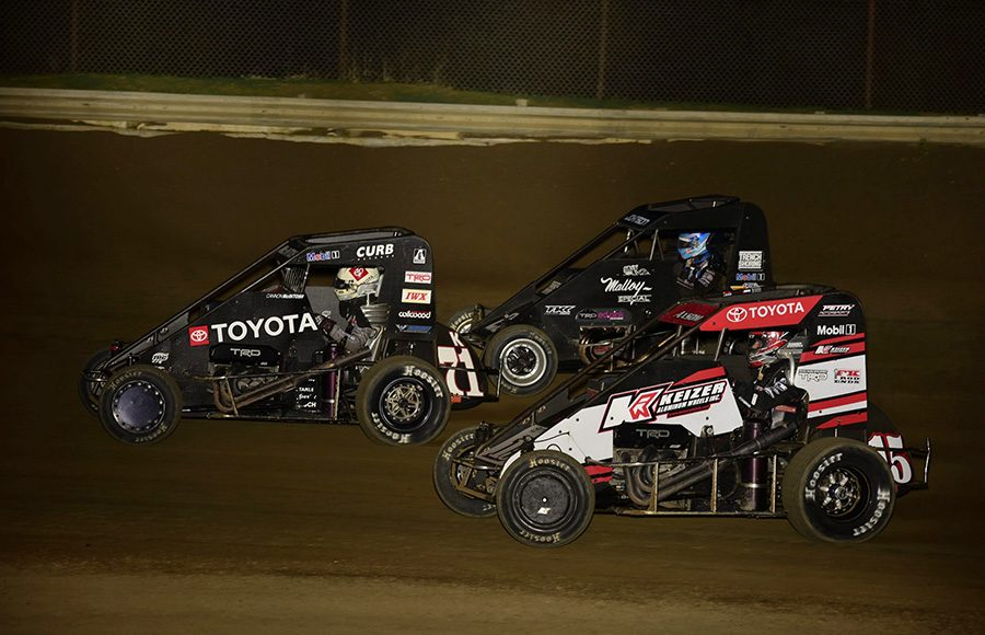 Cannon McIntosh (71k) leads Emerson Axsom (15) and Chase Johnson during Friday's POWRi Lucas Oil National Midget League feature at Charleston Speedway. (Mark Funderburk Photo)