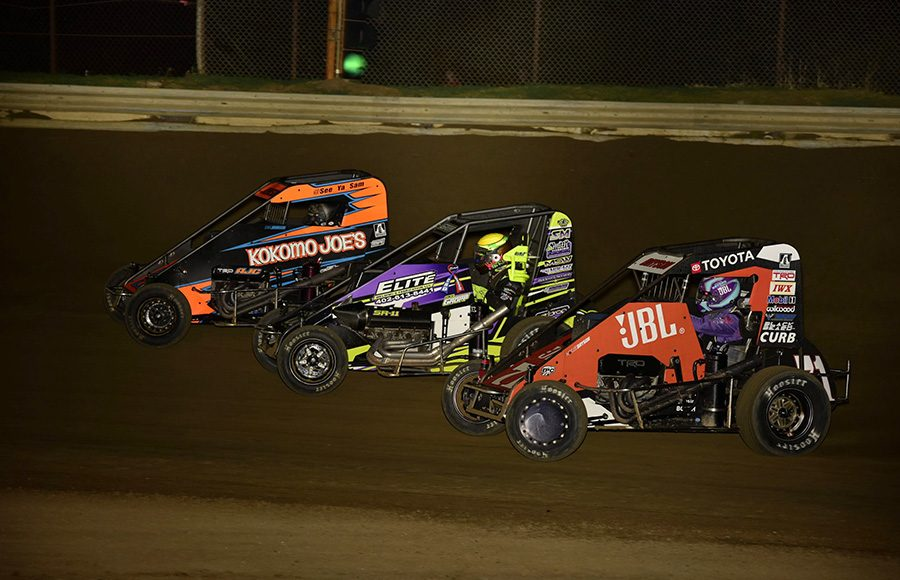 Sam Johnson (72), Trey Gropp (00) and Kaylee Bryson (71) battle for position three-wide during Friday's POWRi Lucas Oil National Midget League feature at Charleston Speedway. (Mark Funderburk Photo)