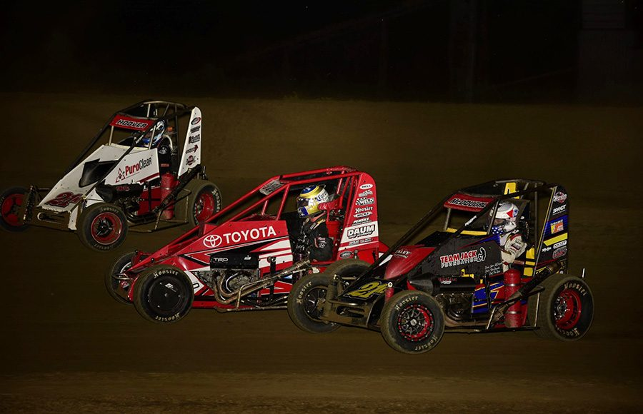 Emilio Hoover (21k), Zach Daum (5D) and Jason McDougal battle for position during Friday's POWRi Lucas Oil National Midget League feature at Charleston Speedway. (Mark Funderburk Photo)