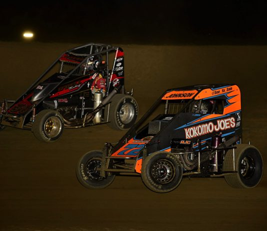 Sam Johnson (72) races under Mitchell Davis during Friday's POWRi Lucas Oil National Midget League feature at Charleston Speedway. (Mark Funderburk Photo)