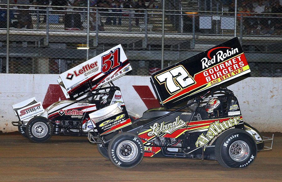Ryan Smith (72) races under Freddie Rahmer during Wednesday's Pennsylvania Speedweek feature at Port Royal Speedway. (Dan Demarco Photo)
