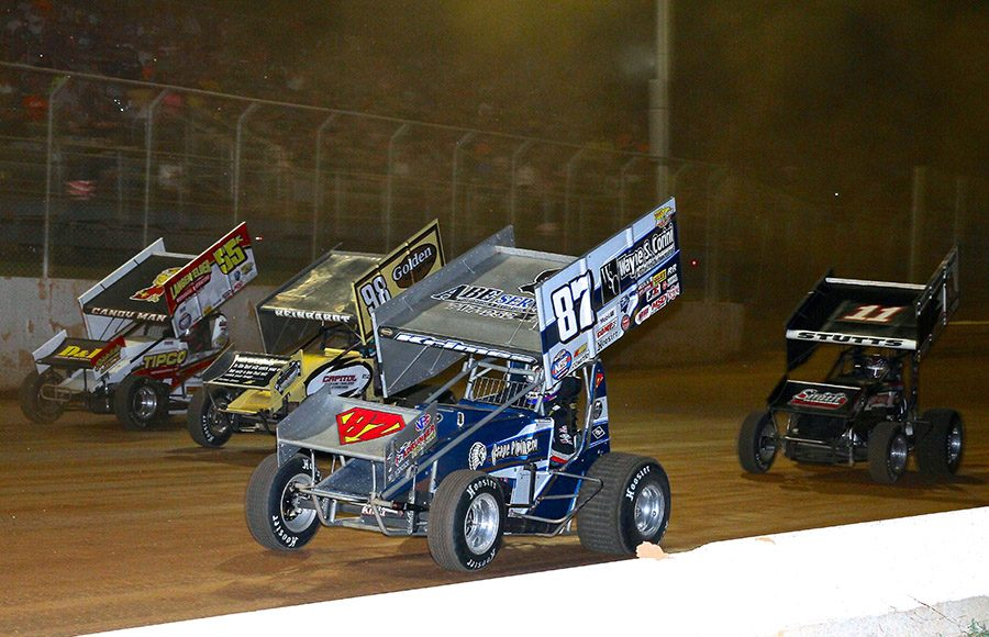 Alan Krimes (87), Kyle Reinhardt (98), Robbie Kendall (55k) and T.J. Stutts battle for position during Wednesday's Pennsylvania Speedweek feature at Port Royal Speedway. (Dan Demarco Photo)