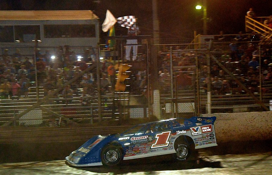 Brandon Sheppard takes the checkered flag to win Friday's Firecracker 100 preliminary feature at Lernerville Speedway. (Hein Brothers Photo)