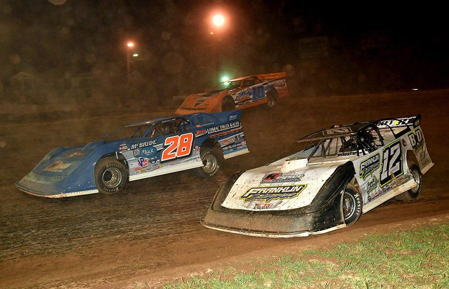 Ashton Winger (12), Dennis Erb Jr. (28) and Alex Ferree battle for position during Friday's Firecracker 100 preliminary event at Lernerville Speedway. (Hein Brothers Photo)