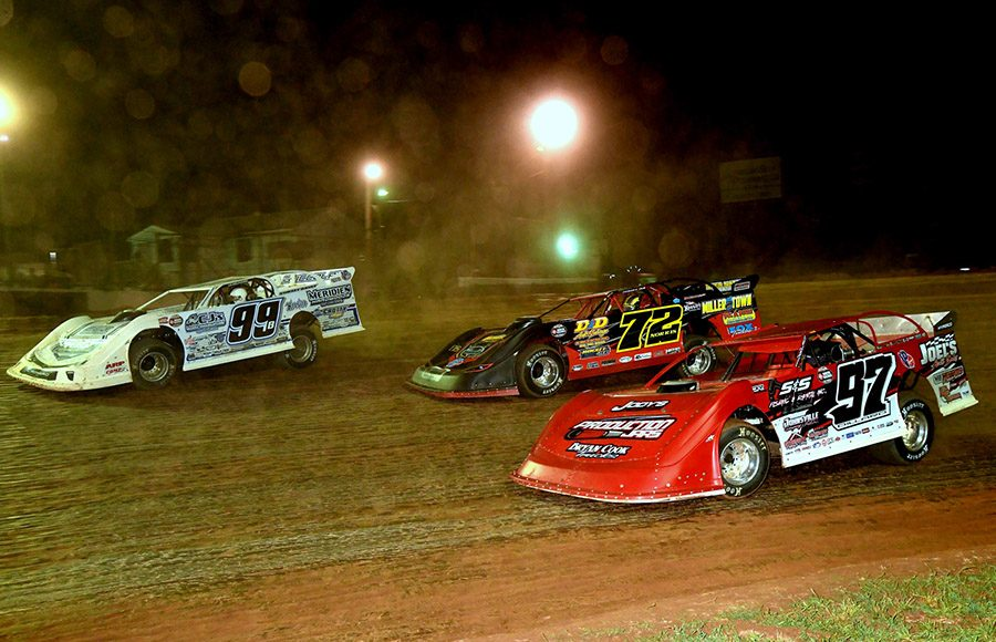 Boom Briggs (99), Mike Norris (72) and Cade Dillard in action during Friday's Firecracker 100 preliminary event at Lernerville Speedway. (Hein Brothers Photo)