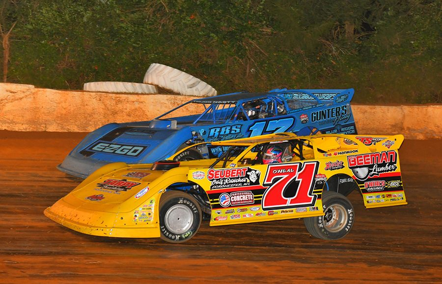 Hudson O'Neal (71) races alongside Logan Roberson during Friday's Lucas Oil Late Model Dirt Series feature at 411 Motor Speedway. (Michael Moats Photo)