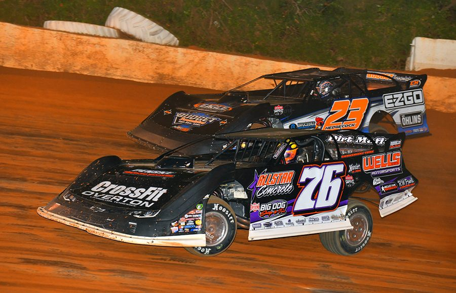 Brandon Overton (76) races under Cory Hedgecock during Friday's Lucas Oil Late Model Dirt Series feature at 411 Motor Speedway. (Michael Moats Photo)