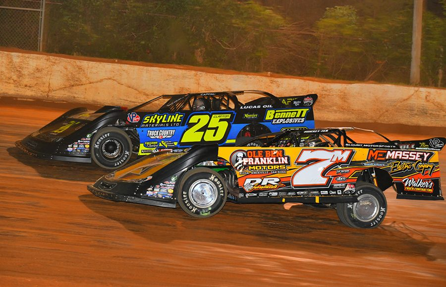 Donald McIntosh (7m) races under Shane Clanton during Friday's Lucas Oil Late Model Dirt Series feature at 411 Motor Speedway. (Michael Moats Photo)