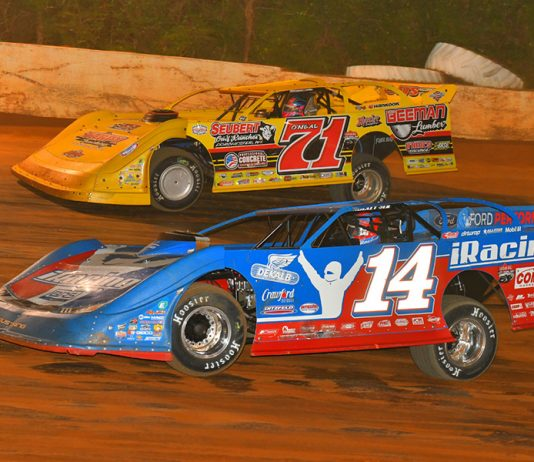 Josh Richards (14) battles Hudson O'Neal during Friday's Lucas Oil Late Model Dirt Series feature at 411 Motor Speedway. (Michael Moats Photo)