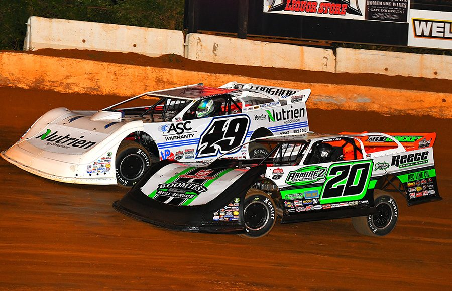 Jimmy Owens (20) fights Jonathan Davenport during Friday's Lucas Oil Late Model Dirt Series feature at 411 Motor Speedway. (Michael Moats Photo)