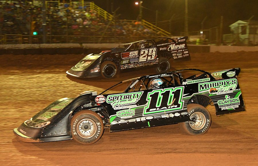 Max Blair (111) races under Darrell Lanigan during Saturday's Firecracker 100 finale at Lernerville Speedway. (Hein Brothers Photo)