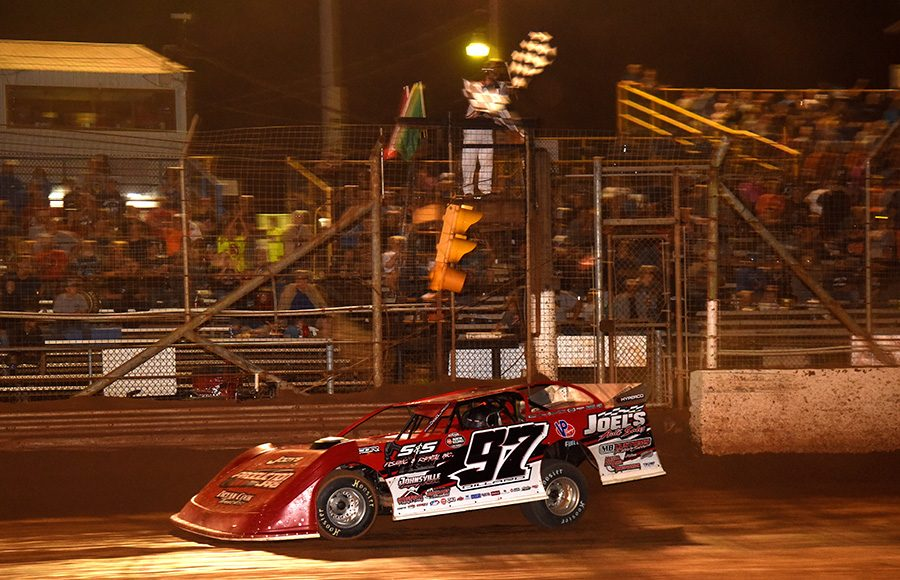 Cade Dillard takes the checkered flag to win Saturday's Firecracker 100 finale at Lernerville Speedway. (Paul Arch Photo)
