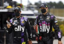 Jimmie Johnson and crew chief Cliff Daniels walk to the grid prior to the NASCAR Cup Series Folds of Honor QuikTrip 500 at Atlanta Motor Speedway on June 7. Johnson will sit out Sunday's race at Indianapolis Motor Speedway after being diagnosed with COVID-19. (Chris Graythen/Getty Images Photo)