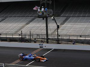 Scott Dixon takes the checkered flag to win Saturday's GMR Grand Prix. (IndyCar Photo)