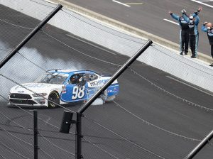 Chase Briscoe celebrates with a burnout after winning Saturday's Pennzoil 150 on the Indianapolis Motor Speedway road course. (Jamie Squire/Getty Images Photo)